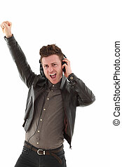 Young adult male dancing and  listening music