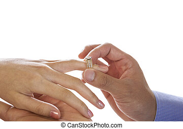 Young Adult Male hand putting engagement ring on Female finger