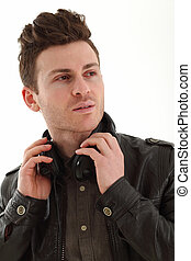 Young adult male portrait listening music