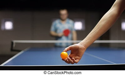 Young adult man playing a game of table tennis