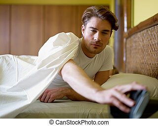 young adult man waking up in the morning