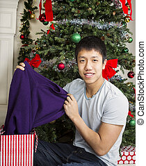 Young Adult Man with Holiday Gifts