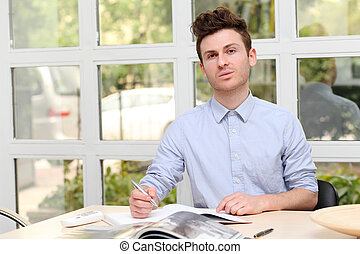 Young adult man writing note
