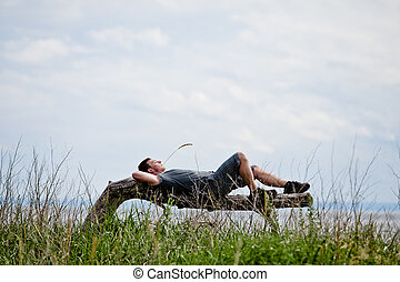 Young Adult Relaxing Peacefully in Nature - Young Adult...