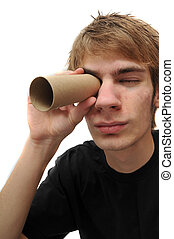 Young adult spying through tube - Young adult looking...