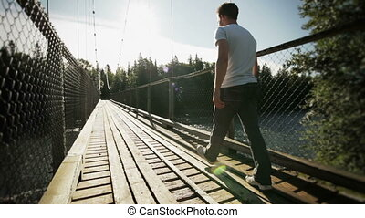 Young Adult Walking on a Hanging Br