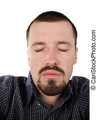 Young adult with closed eyes - Young adult short-haired male...
