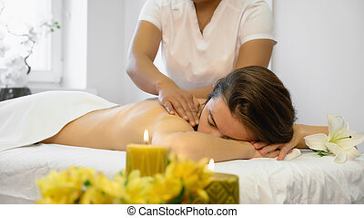 Relaxing young adult woman at the beauty parlor. Young Asian woman doing Vietnamese massage