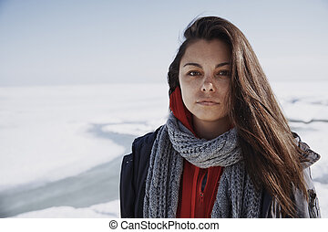 Young adult woman outdoors in icy landscape