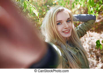Young adult woman spending quality time in the forest