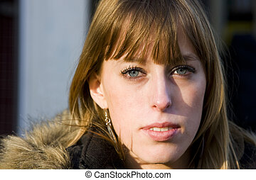 Young Adult Woman with Serious Expression