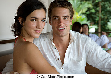 Young Adults - A young couple sitting together in a resort