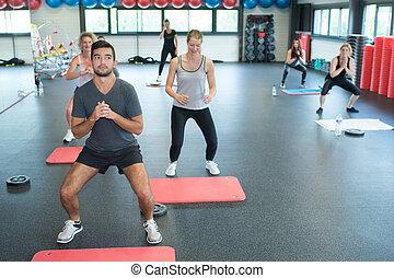 young adults at fitness club