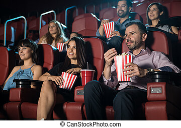 Young adults at the movie theater