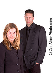 Female & Male Co Workers Dressed In Black Suits
