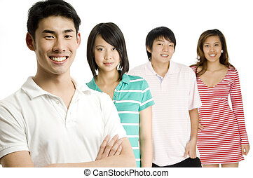 Four young asian adults standing in a group (shallow depth of field used)