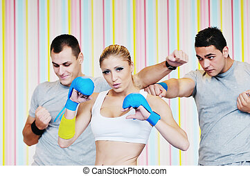 young adults group in fitness club - young adults in group...