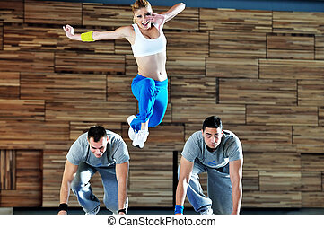 young adults in group have fitness training and representing teamwork concept