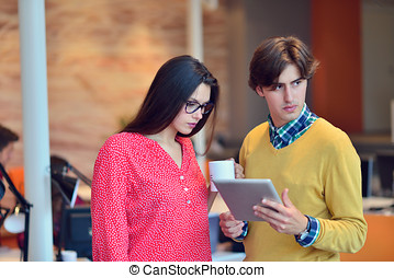 Young adults in training course using touchpad