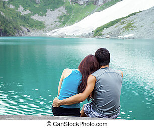 Young Adults Lovers Looking at Pristine Aqua Mountain Lake