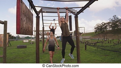 Young adults training at an outdoor gym bootcamp - Front ...