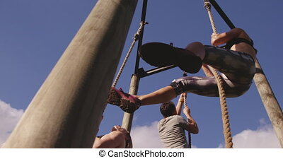 Young adults training at an outdoor gym bootcamp - Low angle...