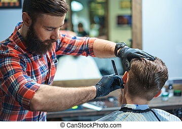 Young adults - Working hairdresser in barber shop