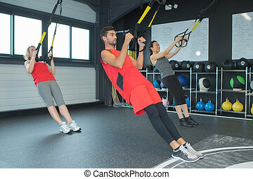 young adults working out in fitness club