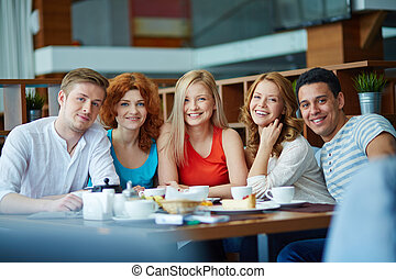 Young adults - Young cheerful people sitting at café