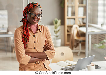 Young Africa-American Woman Standing in Office
