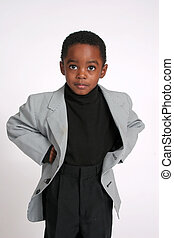 Young african american boy in suit coat