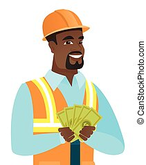 Young african-american builder holding money.