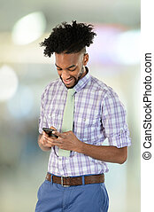Young African American Businessman Using Cell Phone