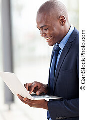 young african american businessman using laptop computer