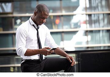 young african american businessman using smart phone