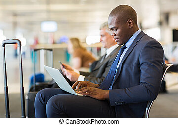 young african american businessman waiting for his flight