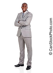young african american businessman with arms folded