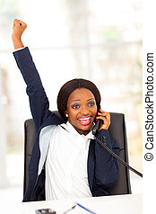 businesswoman receiving exciting news