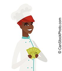 Young african-american chef holding money.