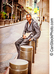 Young African American College Student traveling, studying in New York