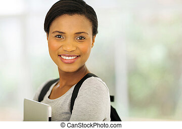 young african american college student holding laptop
