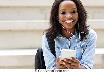 young african american college student with smart phone