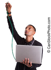 Young african american computer scientist plugin a ethernet ...