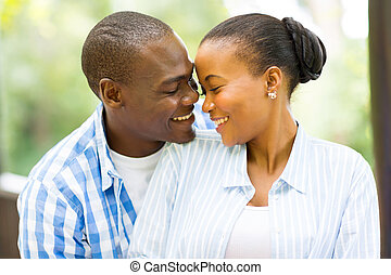 young african american couple looking at each other