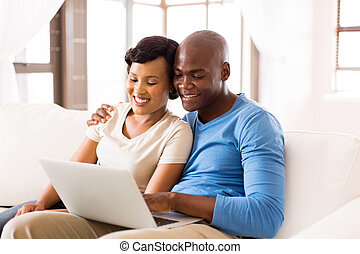 young african american couple using laptop computer