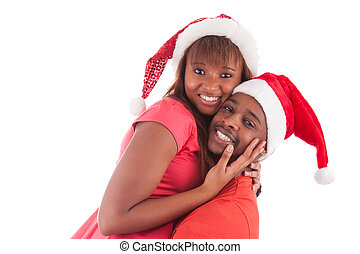 Young african american couple wearing santa hat