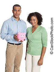 Young African American couple with a pink piggy bank isolated against white background