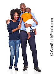 young African American couple with baby standing, isolated...
