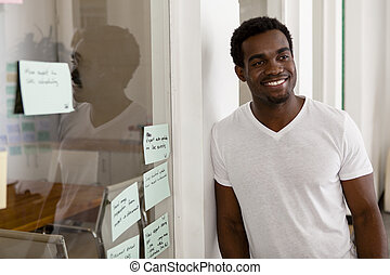 Young African American entrepreneur in his startup office