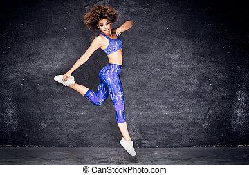 Young african american girl dancing.